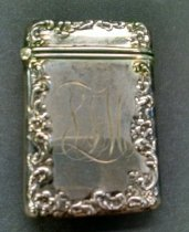 "Image of Sterling Silver Matchsafe - A sterling matchsafe (matchbox) by Bailey Banks and Biddle decorated with Baroque repousse edging.  Monogrammed ""LTM"".  Marked BBB STG 229."