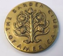 Image of Garden Club of America Medal  1979  - Bronze medal. Garden Club of America medal awarded to the Morris Arboretum 1979 at the Philadelphia Flower Show Abstract tree with three pineapples, two birds and two flowers surrounded by inscription: Garden Club of America Inscription on reverse says 1979 Morris Arboretum. Six creatures (bee, butterfly, bird on next, hummingbird, squirrel, fishing birdseparated by six florets and surrounded by double rows of beading