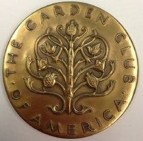Image of Garden Club of America Award   1950 - Bronze Medal  The Garden Club of America On front:  Abstract tree with three pineapples, two birds and two flowers surrounded by embossed letters: Garden Club of America. On back: Six creatures (bee, butterfly, bird on nest, hummingbird, squirrel, fishing bird separated by six florets and surrounded by double rows of beading. Inscription on reverse says Awarded to The Morris Arboretum. Exhibition of shrub and tree breeding. Philadelphia Flower Show.  March 1950.  Boxed.