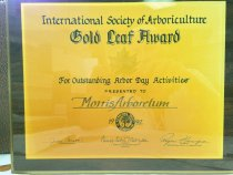 "Image of International Society of Arborculture, 1992 - International Society of Arborculture,  ""Gold Leaf Award""  For Outstanding Arbor Day Activities""  Presented to Morris Arboretum, 1995;  applied gold seal of the ""IS of A"".  For Outstanding Arbor Day Activities.  Commemorative certificate affixed to wood plaque. 