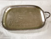 """Image of Pennsylvania Horticultural Society   1974 - Silver tray (missing left handle). Pennsylvania Horticultural Society Award of Merit: 1974 Philadelphia Flower Show Morris Arboretum inscribed on front side. On underside: A crescent, 3 hallmarks of a crowned lion, crescent moon and an aquatic fowl"""", 3116. Tray is rectangular with rounded corners; gadroon edge; flat portion is embelished with floral designs and the inscription above."""