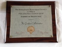 "Image of PHS /Philadelphia Flower Show  1995   - Commemorative certificate affixed to wood plaque 1995.  Inscription:  The Pennsylvania Horticultural Society's 1995 Philadelphia Flower Show--Exhibit of Distinction""  Presented to  ""The Gardens Collaborative""  Signed by Diane Allen, Flower Show Chair and Jane Pepper, President
