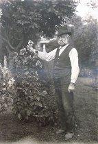 Image of Gardener Frank Gould with Dahlias - 2014.40.23