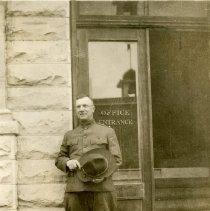 Image of Man at hospital door