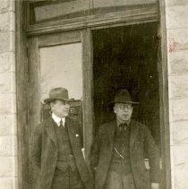 Image of Two men at Hospital door
