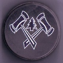 Image of 2012.01.36.8 - Puck:  Hockey Puck from Alumni/Parent Game, January, 2012