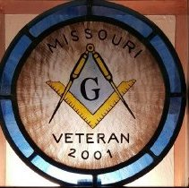 Image of GM Freddie Adams Stained Glass representaton of the Grand Masters pin - 2016.3.39