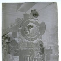 Image of B&O roundhouse, washing out heater pipes in big locomotive.