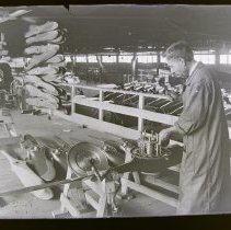 Image of Putting hub on motor in Curtiss aircraft factory. Buffalo, NY.