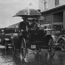 Image of 1938 Stonington, Maine parade with Breeze automobile