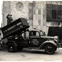 Image of L.K. Burket and Bro. Coal/Fuel Oil/Feed dumptruck outside dealership
