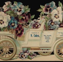 Image of Embossed ad card: automobile overflowing with posies, ca. early 1920's