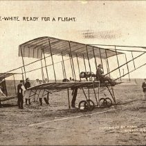 Image of Real photo postcard: aviator Claude Grahame-White in airplane on field, ca.