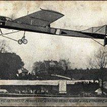 Image of Real photo postcard: Hubert Latham flying Antoinette plane, Maryland, 1910