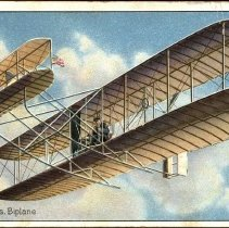 Image of Embossed color postcard showing Wright Brothers biplane