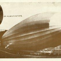 Image of Postcard/RPPC showing Graf Zeppelin & cartouche of Hugo Eckener