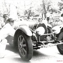 "Image of Black & white photograph of Bill Milliken with the Doc Scher Bugatti Type 54 at the 1950 Bridgehampton, NY race - William F. ""Bill"" Milliken, Jr. Collection"