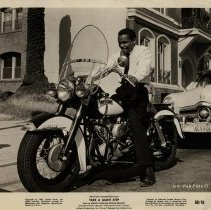 "Image of Johnny Nash/Harley-Davidson Duo-Glide: 1960 film still, ""Take a Giant Step"""