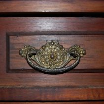 Image of Close-up of handle (proper right, second drawer from top)