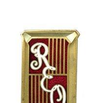 Image of REO Tie Badge