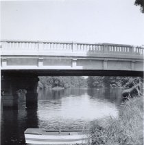 Image of Boat Banked by Bridge