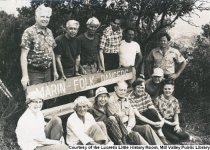 Image of Group posing around the Marin Folk Dancers bench, 1970's - Print, Photographic