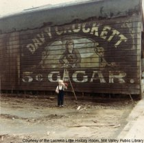 Image of Bill Lescohier in front of Davy Crockett sign on Throckmorton Avenue, 1965