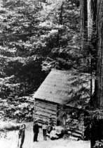 Image of Ben Johnson cabin in Muir Woods with John Muir in foreground, circa 1910.