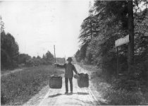 Image of Suey Kee walking with produce on carrying pole, 1902 - Print, Photographic
