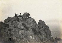 Image of Men and women sitting on East Peak of Mt. Tamalpais, circa 1880s - 1890s