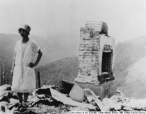 Image of Lucille Frank Hughes at burned home on Middle Ridge,1929