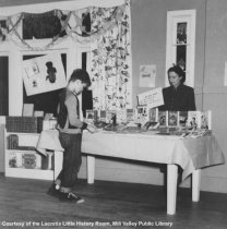 Image of Carnegie Library - boy & librarian at first Book Week, 1948