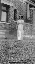 Image of Woman in front of library, 1911