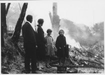 Image of Hermann family at remains of their residence, 1929