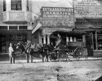 Image of The Emporium wagon, with Edwin Ezekiel and Jack Harris, circa 1910                                                                                                                                                                               - Print, Photographic