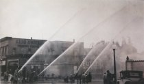 Image of Firemen spraying fire hoses, early 1900s - Print, Photographic
