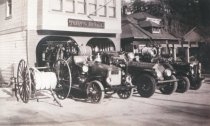 Image of Fire trucks outside of fire station, early 1900's