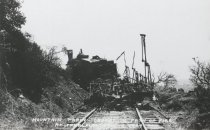 Image of Train on mountain railroad tracks damaged by fire, 1929                                                                                                                                                                                            - Print, Photographic