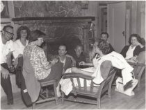 Image of West Point Inn; gathering of people around fireplace circa 1960                                                                                                                                                                                    - Print, Photographic