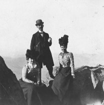 Image of Three people opn the top of Mt. Tamalpais, date unknown                                                                                                                                                                                                    - Print, Photographic