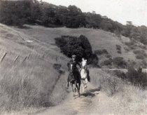 Image of Uniden family horseback riding on Mt. Tamalpais                                                                                                                                                                                                                - Print, Photographic