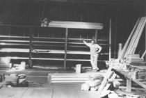 Image of C. Russell Symes in Symes Plumbing Shop, 1927                                                                                                                                                                                                                  - Print, Photographic