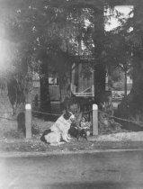 "Image of Bernard Grethel Jr. ""babysitting"" dog, circa 1910                                                                                                                                                                                                         - Print, Photographic"