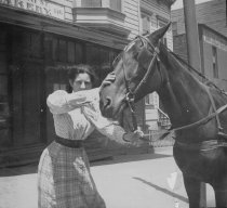 Image of Kate Robinson with a horse, 1900 - Photograph