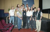 Image of Kristi Denton-Cohen with a large group at the Mill Valley Film Festival, 20