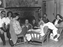 Image of West Point Inn group by fireplace                                                                                                                                                                             - Print, Photographic