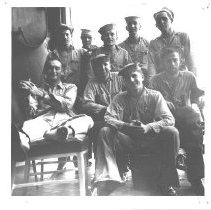Image of Richard C. Walker with sailors - 1993.022.0003