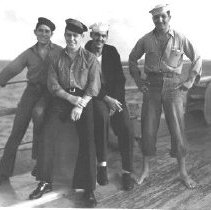 Image of Alfred Sparado (standing far right) and three sailors - 1993.022.0025