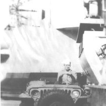 Image of George Boltz on ship jeep