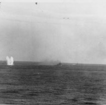 Image of Maneuvering Ships Under Air Attack Firing Aft